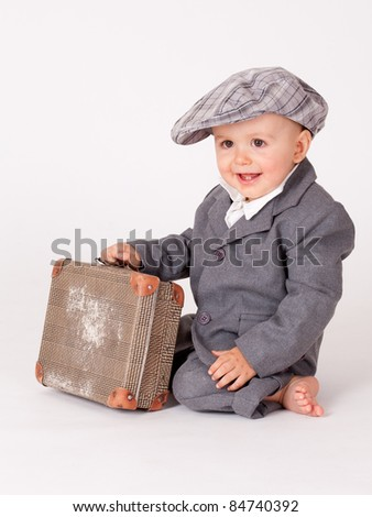Little boy with suitcase over white - stock photo