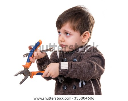 little boy with the pliers on white  - stock photo