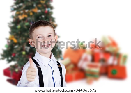 Little boy with thumb up gesture isolated over grey background.Portrait of confident happy little boy showing thumbs up gesture wearing costume  isolated over white - stock photo