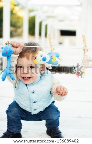 little boy with toy smiling - stock photo