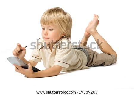 Little boy working with PDA, studio shot - stock photo