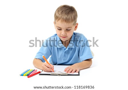 Little boy writing with pencils on white background - stock photo