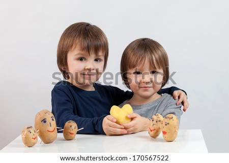 Little boys with funny potatoes