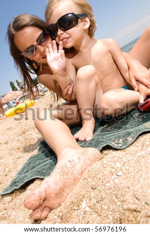 Little brother and sister spending their vacation at the summer resort - stock photo