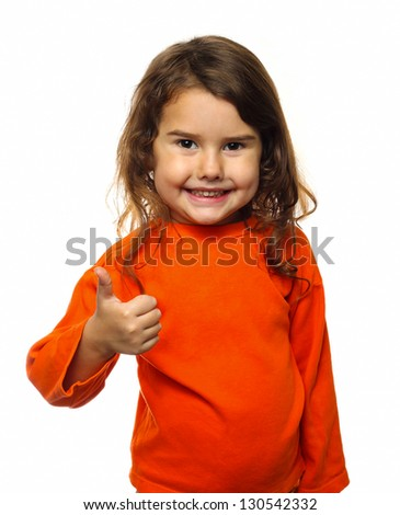 Little brunette curly girl in an orange jacket, showing thumbs up isolated on white background - stock photo