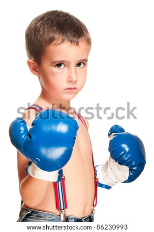 Little bully boy with black eye in boxing gloves fighting stance isolated on white - stock photo