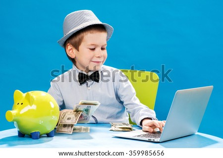 Little businessman counting money - stock photo