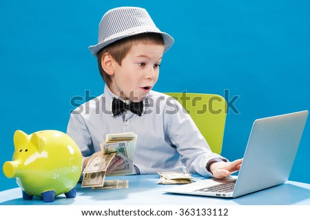 Little businessman counting money