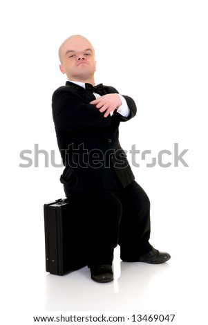 Little businessman, dwarf in a formal suit with bow tie next suitcase, studio shot, white background
