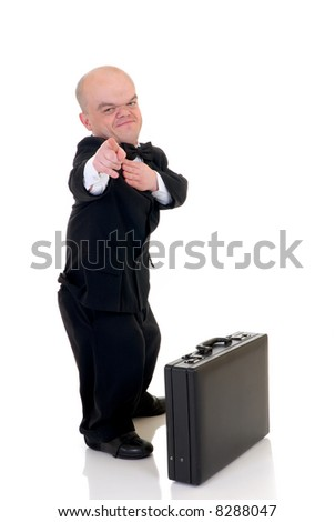Little businessman, dwarf in a formal suit with bow tie next suitcase, studio shot, white background - stock photo