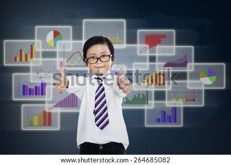 Little businessman giving thumbs up with business interface background - stock photo