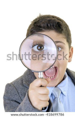 Little businessman is looking from magnifying glass and getting surprised and smiling to the camera against isolated white background.