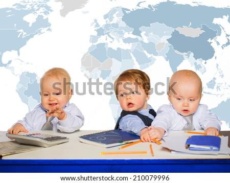 Little businessman portrait in office - stock photo