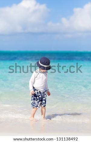 little caucasian boy enjoying his day at the caribbean beach - stock photo