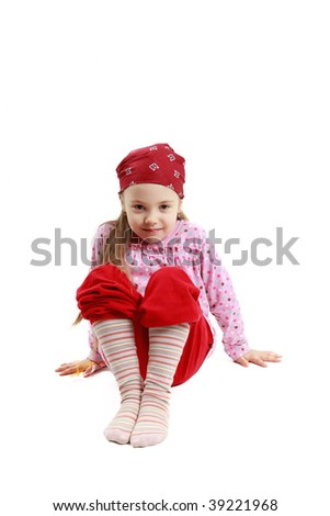 little caucasian girl sit and posing on white background