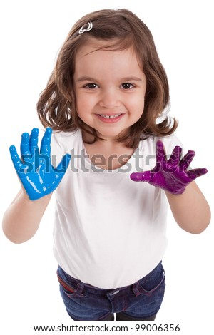 Little caucasian girl with hands painted in colorful paints - stock photo