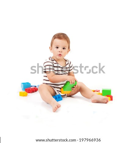 little cheerful baby boy with construction on white background - stock photo
