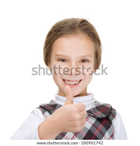 Little cheerful girl lifts thumb upwards, isolated on white background. - stock photo