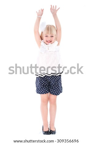 Little cheerful girl schoolgirl isolated on a white background with hands raised - stock photo