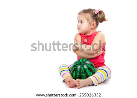 little cheerful girl with a ball on a white background - stock photo