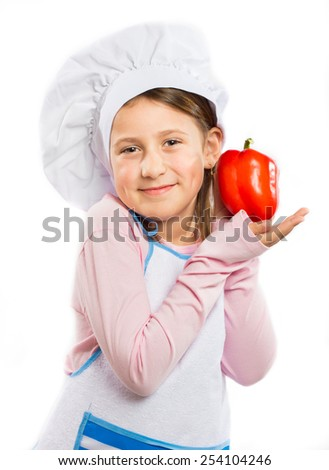 Little chef holding a  red pepper - stock photo