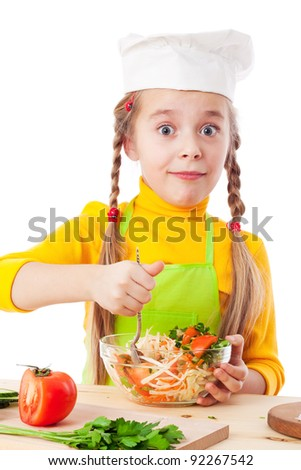 Little chef mix the salad, isolated on white - stock photo