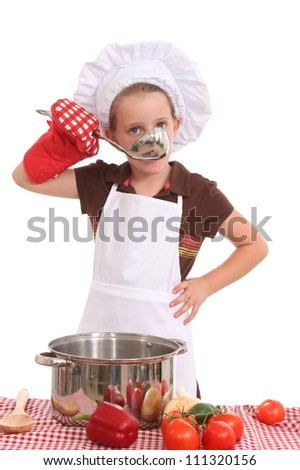 Little chef with a large spoon - stock photo