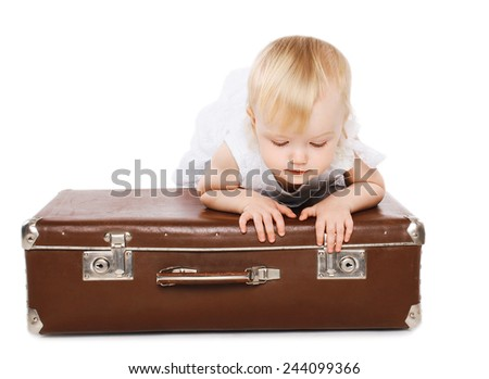 Little child and a suitcase, family travel - concept - stock photo