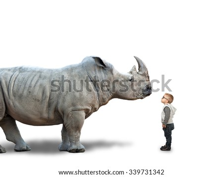 little child and huge rhino on white - stock photo