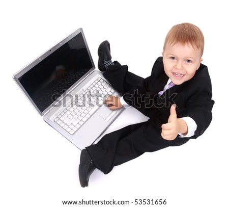 Little child and laptop Isolated on white background - stock photo