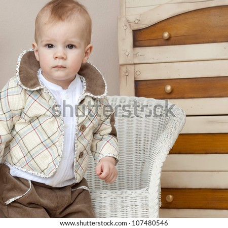 little child baby boy  indoors in baby room smiling happy - stock photo