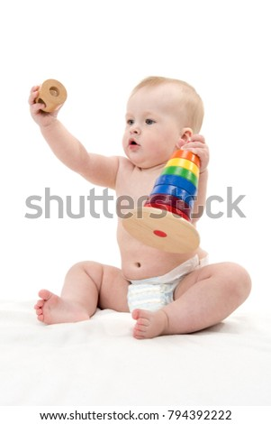 little child baby isolated on white studio shot sitting playing