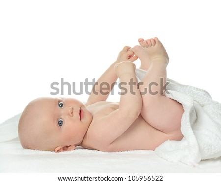 little child baby  portrait isolated on white studio shot lying on white towel looking at camera - stock photo