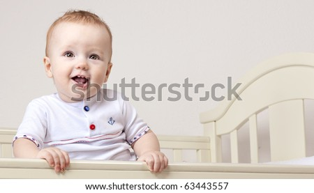 little child baby smiling in bed