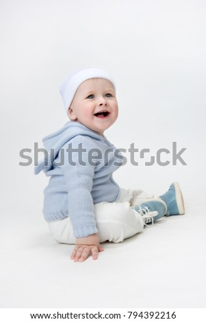 little child baby smiling  isolated on white studio shot face positive happy in warm clothing hat