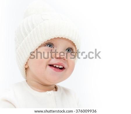 little child baby smiling portrait hat warm clothing isolated on white studio shot - stock photo
