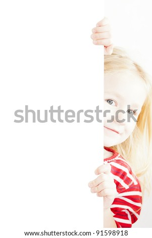 little child behind white board. See my portfolio for more - stock photo