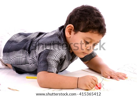 Little child boy drawing by crayon on floor
