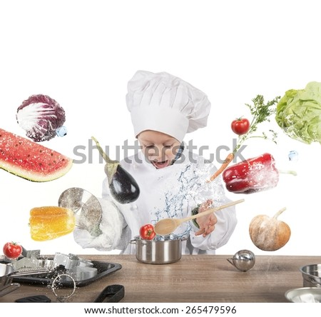 Little child chef playing and having fun - stock photo