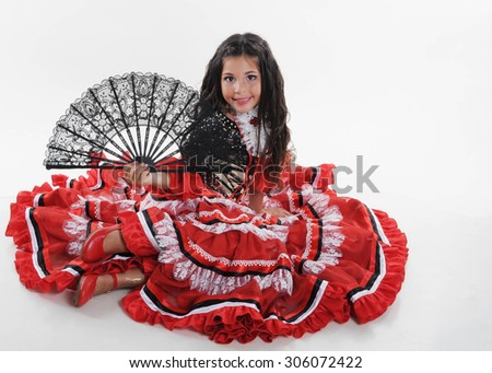 Little child dancing spanish dance. Small girl in red costume - stock photo