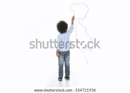 little child drawing his mum on the wall with chalk - stock photo