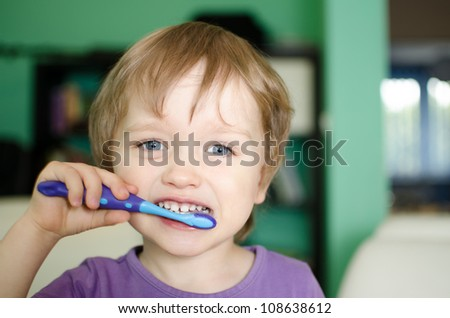 Little child during brushing his teeth