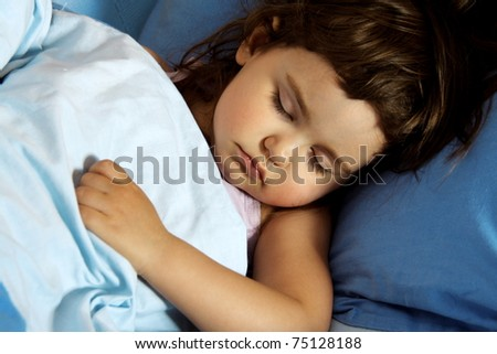 Little Child Girl Asleep in Her Bed