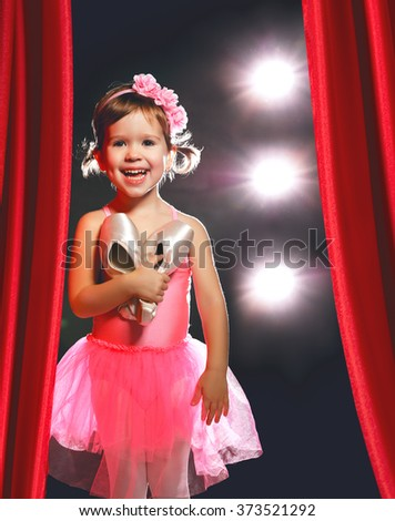 little child girl ballerina ballet dancer on the stage in red side scenes - stock photo