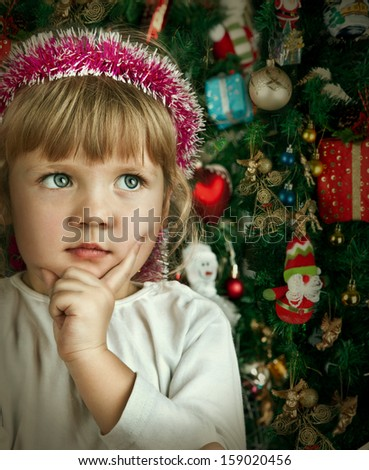 Little child girl near Christmas tree. Happy new year - stock photo