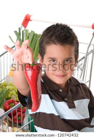 Little child holding red pepper - stock photo
