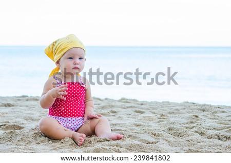 Little child on the beach - stock photo