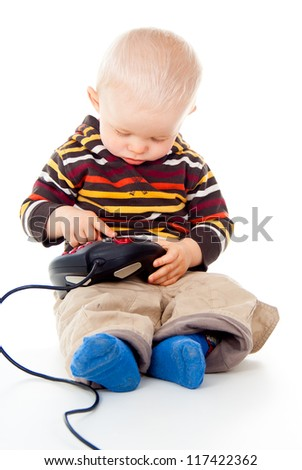 little child plays with a joystick