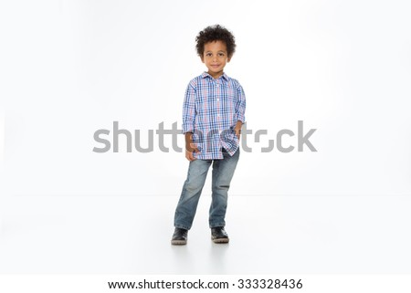 little child posing and standing looking at the camera - stock photo