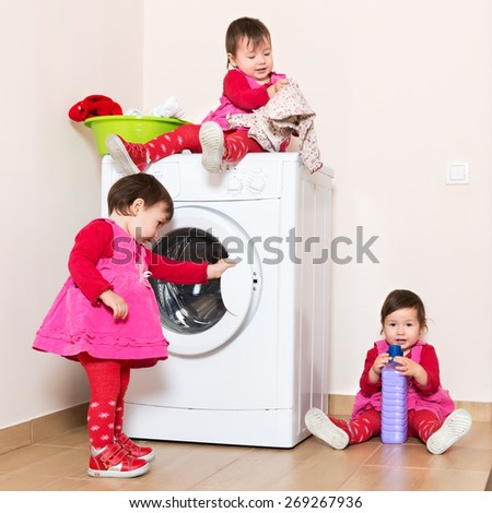 Little child using washing machine - stock photo